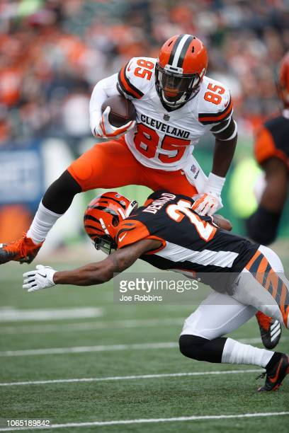 David Njoku of the Cleveland Browns attempts to hurdle Darqueze Dennard of the Cincinnati Bengals during the first quarter at Paul Brown Stadium on...