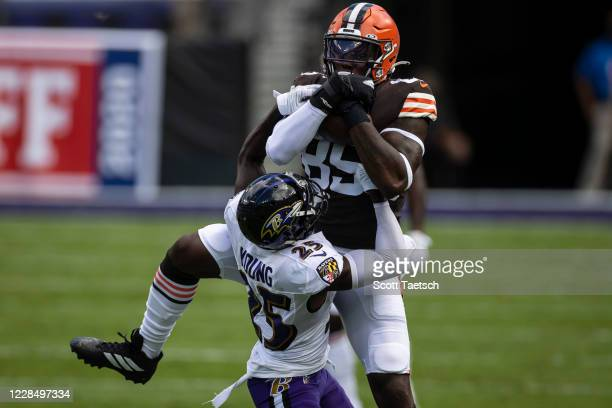 David Njoku of the Cleveland Browns catches a pass against Tavon Young of the Baltimore Ravens during the first half at M&T Bank Stadium on September...