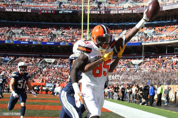 David Njoku of the Cleveland Browns celebrates a touchdown catch in the fourth quarter against the Los Angeles Chargers at FirstEnergy Stadium on...