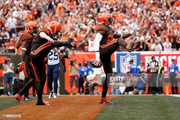 David Njoku of the Cleveland Browns celebrates a touchdown with Baker Mayfield during the third quarter of the game against the Tennessee Titans at...