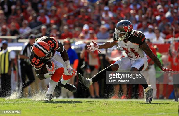 David Njoku of the Cleveland Browns is tackled by Justin Evans of the Tampa Bay Buccaneers during a game at Raymond James Stadium on October 21 2018...