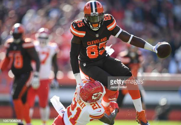 David Njoku of the Cleveland Browns is tripped up by Eric Murray of the Kansas City Chiefs during the first half at FirstEnergy Stadium on November 4...