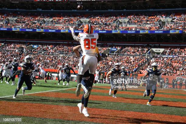David Njoku of the Cleveland Browns makes a touchdown catch defended by Trevor Williams of the Los Angeles Chargers in the fourth quarter at...