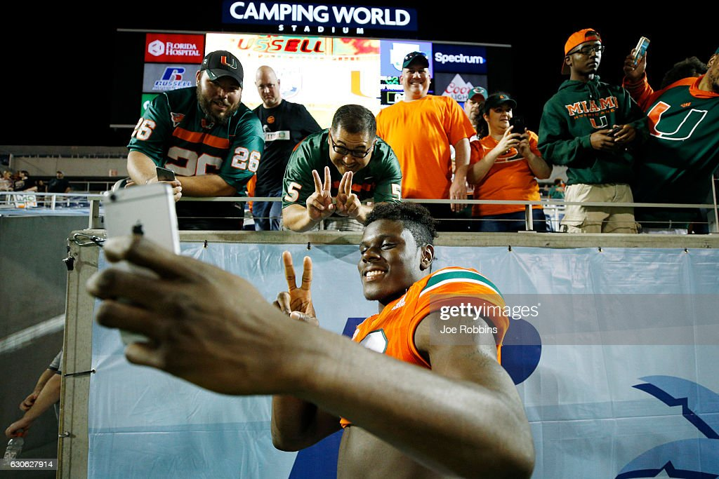 David Njoku #86 of the Miami Hurricanes celebrates with fans following the Russell Athletic Bowl against the West Virginia Mountaineers at Camping World Stadium on December 28, 2016 in Orlando, Florida. Miami defeated West Virginia 31-14.