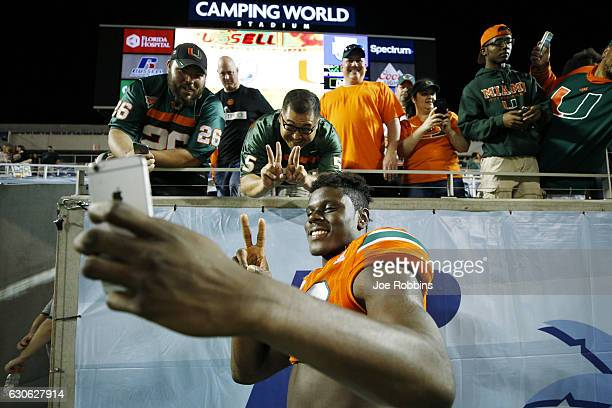 David Njoku of the Miami Hurricanes celebrates with fans following the Russell Athletic Bowl against the West Virginia Mountaineers at Camping World...
