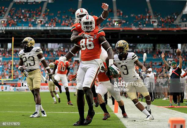 David Njoku of the Miami Hurricanes celebrates with teammates after scoring a touchdown during the first quarter of the game against the Pittsburgh...