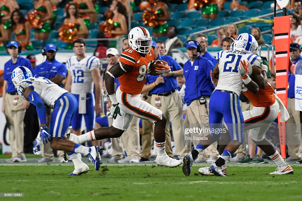 David Njoku #86 of the Miami Hurricanes scores on a 76 yard touchdown reception during the 4th quarter against the Duke Blue Devils at Hard Rock Stadium on November 26, 2016 in Miami Gardens, Florida.