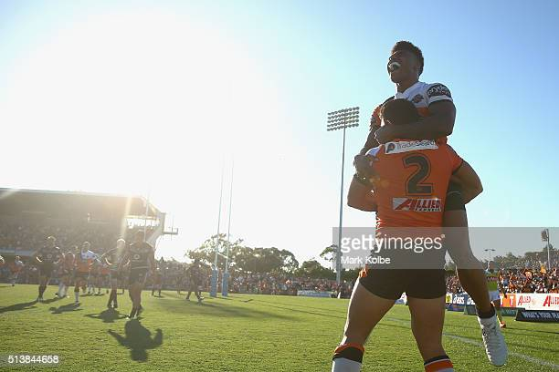 David Nofoaluma and Kevin Naiqama celebrate David Nofoaluma scoring a try during the round one NRL match between the Wests Tigers and the New Zealand...