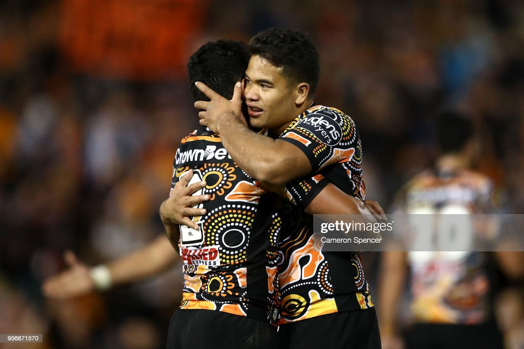 David Nofoaluma of the Tigers and Esan Nike Marsters of the Tigers embrace after winning the round 10 NRL match between the Wests Tigers and the North Queensland Cowboys at Leichhardt Oval on May 10, 2018 in Sydney, Australia.
