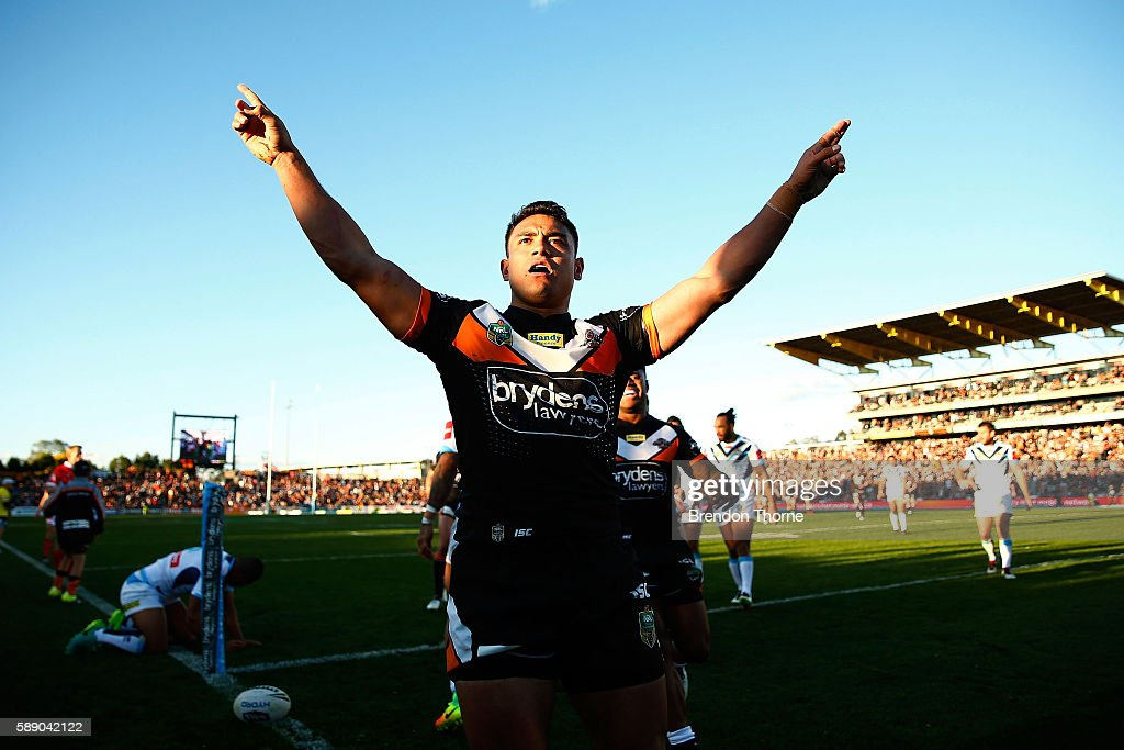 David Nofoaluma of the Tigers celebrates after scoring a try during the round 23 NRL match between the Wests Tigers and the Gold Coast Titans at Campbelltown Sports Stadium on August 13, 2016 in Sydney, Australia.