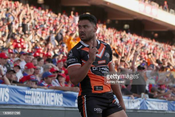 David Nofoaluma of the Tigers celebrates his try during the round three NRL match between the Newcastle Knights and the Wests Tigers at McDonald...