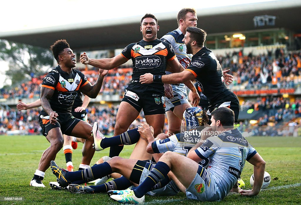 David Nofoaluma of the Tigers celebrates scoring a try during the round 22 NRL match between the Wests Tigers and the North Queensland Cowboys at Leichhardt Oval on August 7, 2016 in Sydney, Australia.