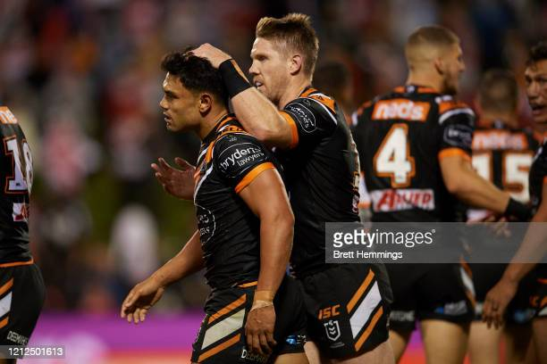 David Nofoaluma of the Tigers celebrates scoring a try with team mates during the round 1 NRL match between the St George Illawarra Dragons and the...