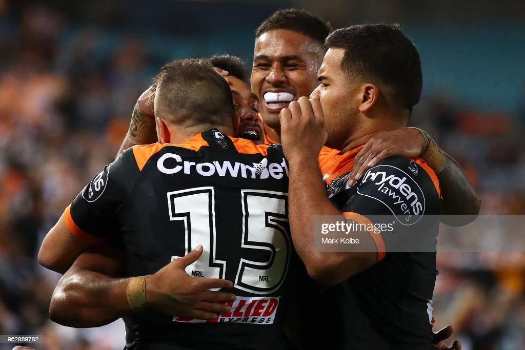David Nofoaluma of the Tigers celebrates with his team mates after scoring a try during the round 12 NRL match between the Wests Tigers and the Canterbury Bulldogs at ANZ Stadium on May 27, 2018 in Sydney, Australia.