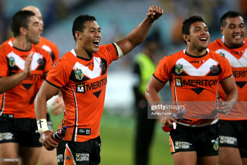 David Nofoaluma of the Tigers celebrates with teammates after winning during the round seven NRL match between the Parramatta Eels and the Wests Tigers at ANZ Stadium on April 21, 2014 in Sydney, Australia.