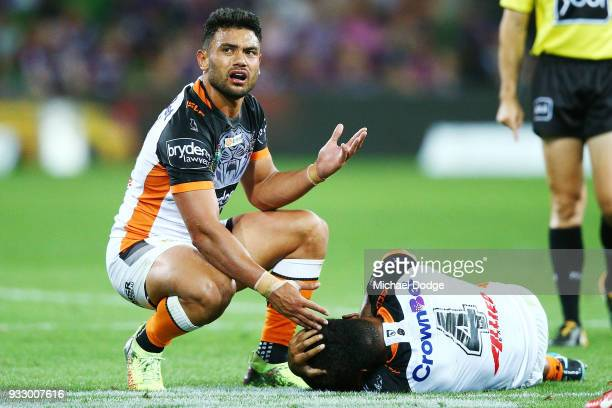David Nofoaluma of the Tigers gestures after Kevin Naiqama of the Tigers was taken off after a tackle by Cameron Munster of the Storm and Cameron...