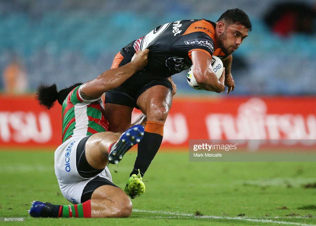 David Nofoaluma of the Tigers is tackled by Siosifa Talakai of the Rabbitohs during the round one NRL match between the South Sydney Rabbitohs and the Wests Tigers at ANZ Stadium on March 3, 2017 in Sydney, Australia.