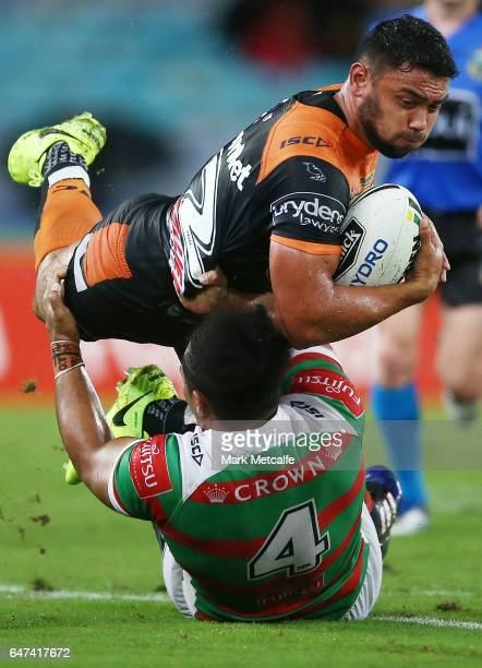 David Nofoaluma of the Tigers is tackled by Siosifa Talakai of the Rabbitohs during the round one NRL match between the South Sydney Rabbitohs and...