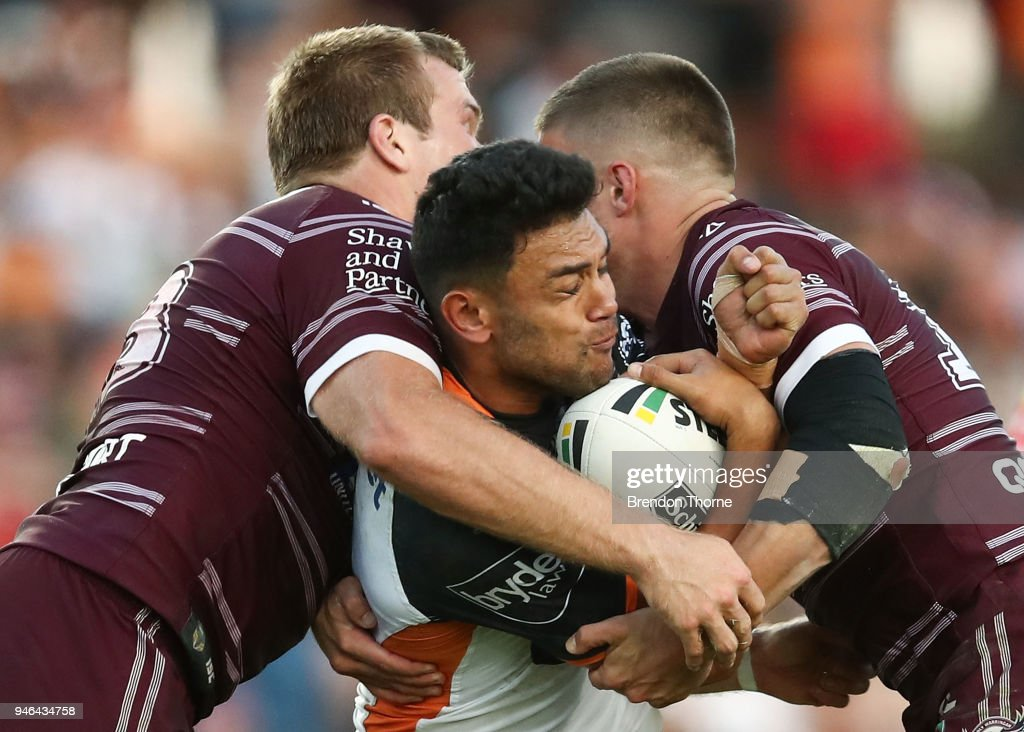 David Nofoaluma of the Tigers is tackled by the Sea Eagles defence during the round six NRL match between the Manly Sea Eagles and the Wests Tigers at Lottoland on April 15, 2018 in Sydney, Australia.
