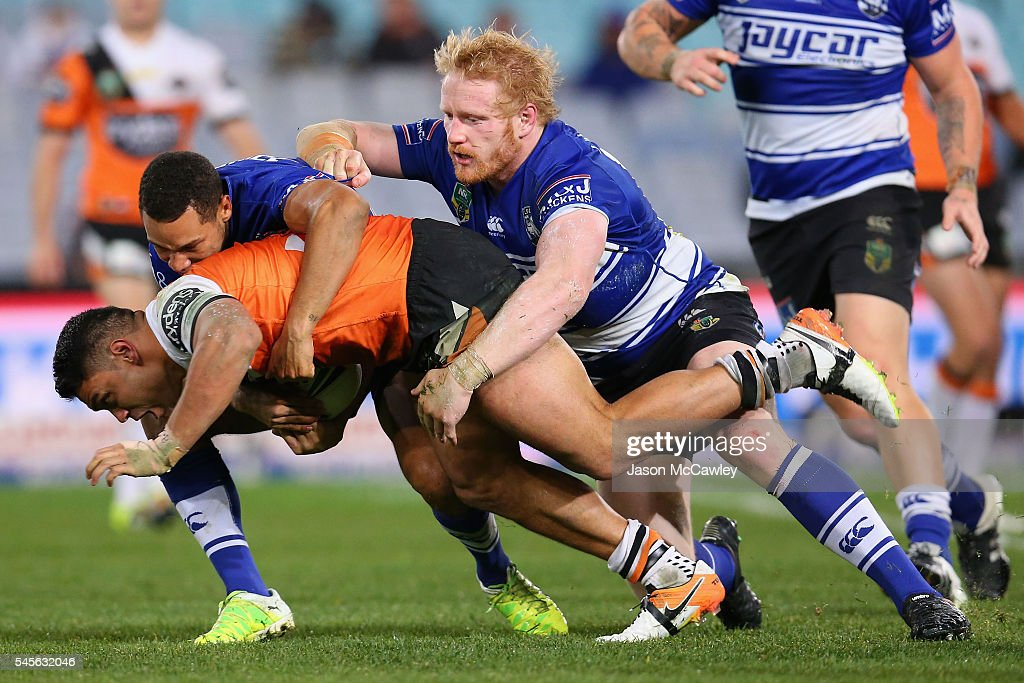 David Nofoaluma of the Tigers is tackled during the round 18 NRL match between the Canterbury Bulldogs and the Wests Tigers at ANZ Stadium on July 9, 2016 in Sydney, Australia.