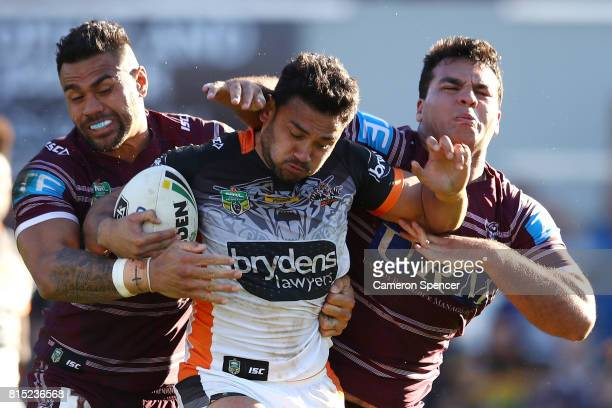 David Nofoaluma of the Tigers is tackled during the round 19 NRL match between the Manly Sea Eagles and the Wests Tigers at Lottoland on July 16 2017...