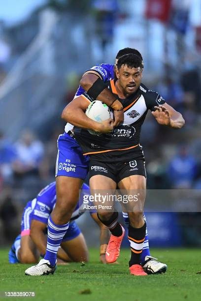 David Nofoaluma of the Tigers is tackled during the round 25 NRL match between the Wests Tigers and the Canterbury Bulldogs at Moreton Daily Stadium,...