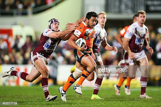 David Nofoaluma of the Tigers runs the ball during the round 18 NRL match between the Manly-Warringah Sea Eagles and the Wests Tigers at Brookvale...