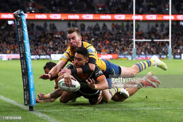 David Nofoaluma of the Tigers scores a try during the round 17 NRL match between the Wests Tigers and the Parramatta Eels at Bankwest Stadium on July...