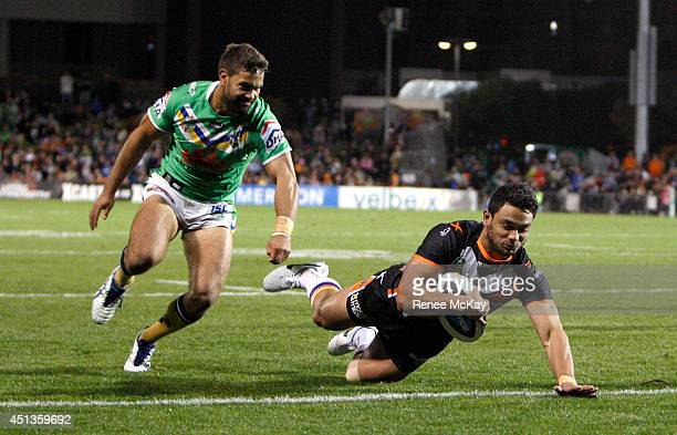 David Nofoaluma of the Tigers scores his first try during the round 16 NRL match between the Wests Tigers and the Canberra Raiders at Campbelltown...