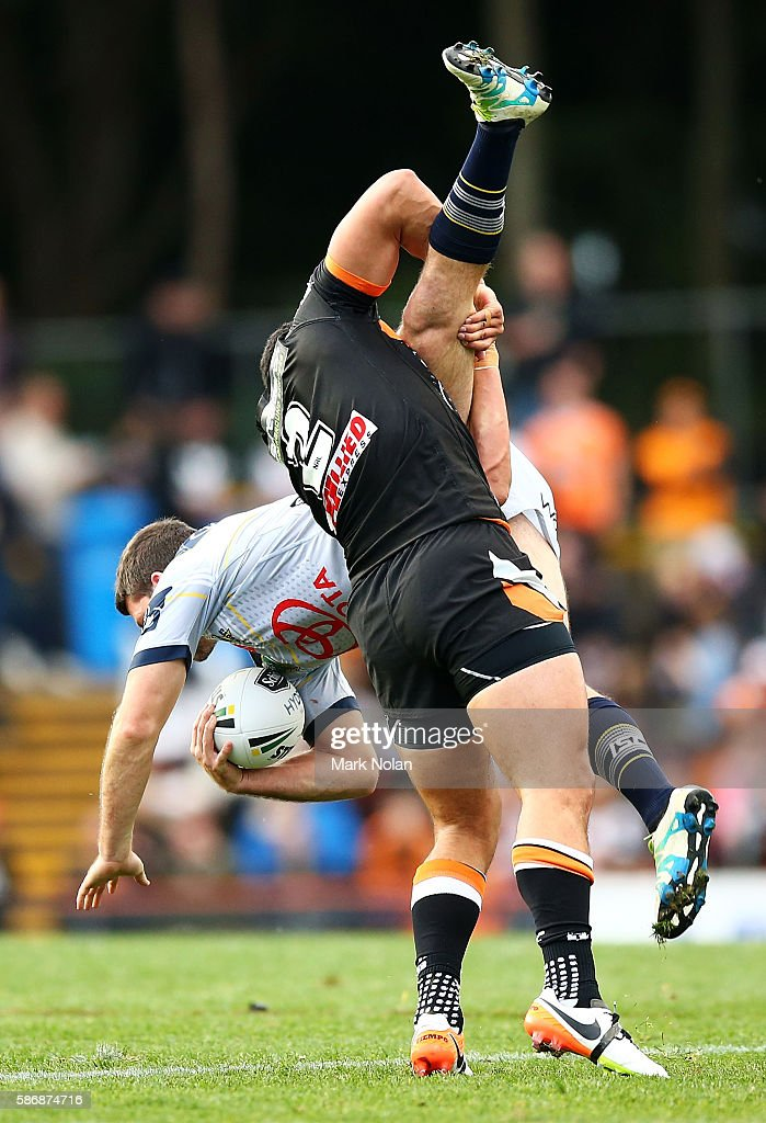 David Nofoaluma of the Tigers spear tackles Lachlan Coote of the Cowboys during the round 22 NRL match between the Wests Tigers and the North Queensland Cowboys at Leichhardt Oval on August 7, 2016 in Sydney, Australia.
