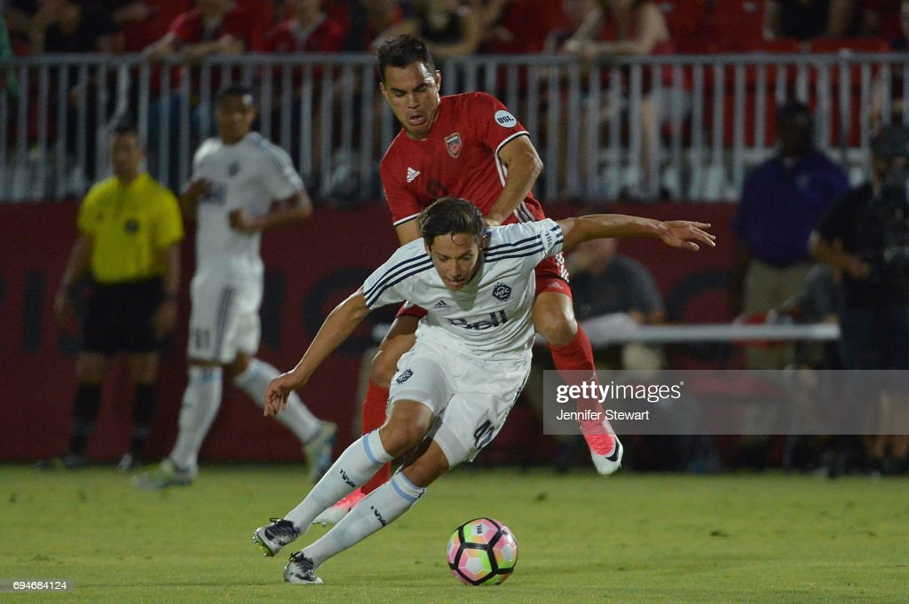 David Norman Jr. #42 of Vancouver Whitecaps II dribbles the ball in front of Omar Bravo #9 of Phoenix Rising FC in the match at Phoenix Rising Soccer Complex on June 10, 2017 in Phoenix, Arizona.