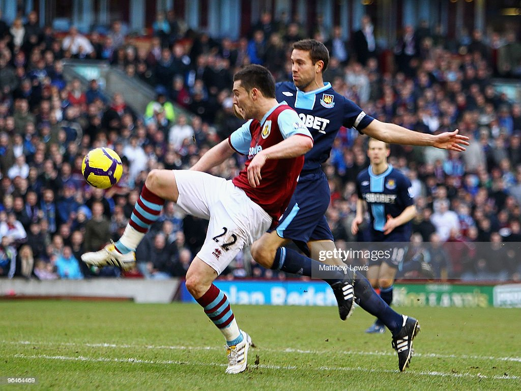 David Nugent of Burnley beats Matthew Upson of West Ham to score a goal during the Barclays Premier League match between Burnley and West Ham United at Turf Moor on February 6, 2010 in Burnley, England.