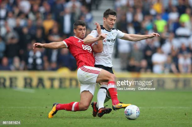 David Nugent of Derby County is tackled by Eric Lichaj of Nottingham Forest during the Sky Bet Championship match between Derby County and Nottingham...