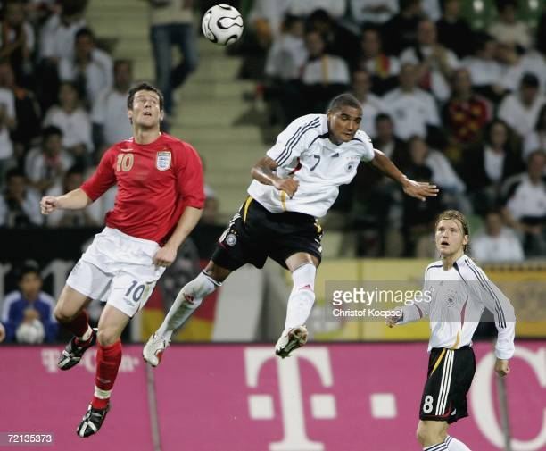 David Nugent of England and Kevin Boateng of Germany go up for a header during the Men's European U21 Championship qualifying second leg game between...