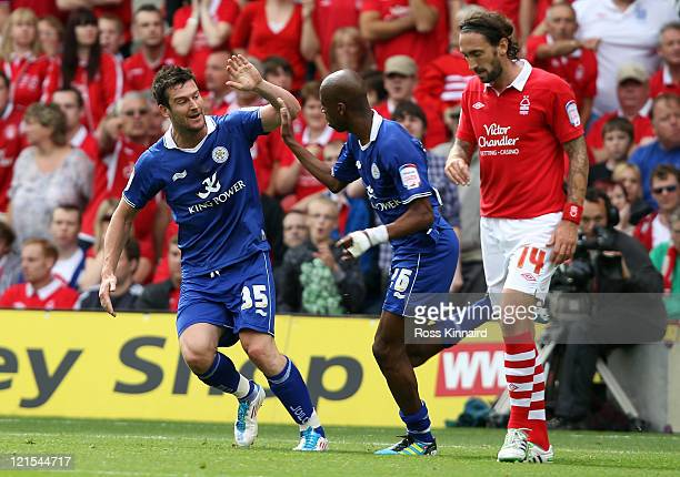 David Nugent of Leicester celebrates with Gelson Fernandez of Leicester after he scores the opening goal during the npower Championship match between...