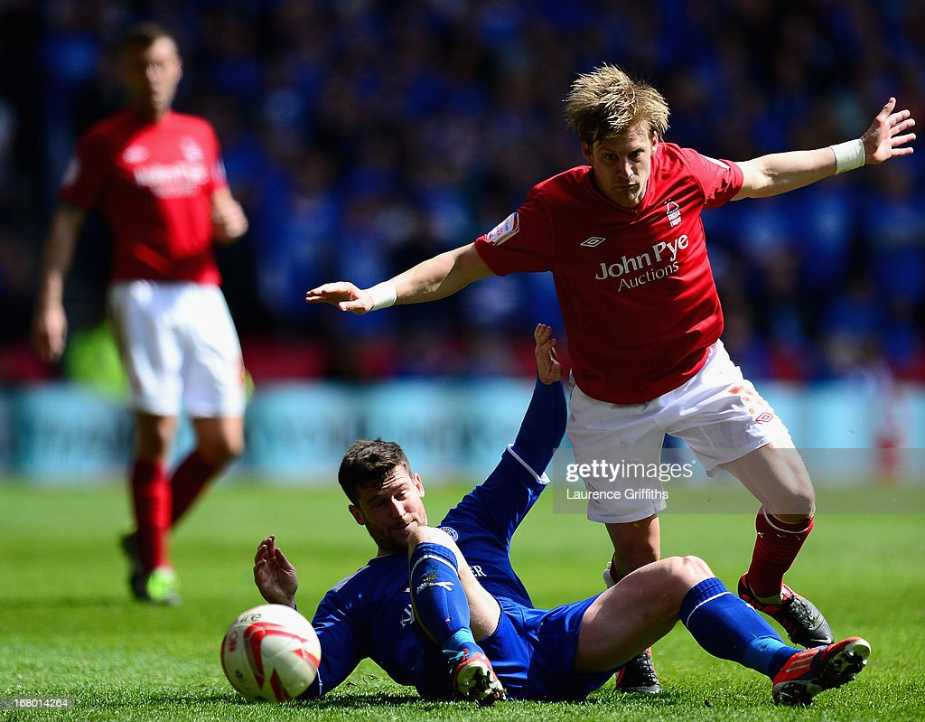 David Nugent of Leicester City battles with Dan Harding of Nottingham Forest during the npower Championship match between Nottingham Forest and Leicester City at City Ground on May 4, 2013 in Nottingham, England.