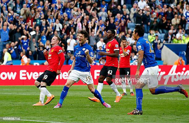 David Nugent of Leicester City celebrates after scoring his team's second goal from the penalty spot during the Barclays Premier League match between...