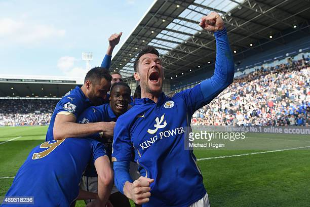 David Nugent of Leicester City celebrates with teammates after the late Vardy goal during the Barclays Premier League match between West Bromwich...