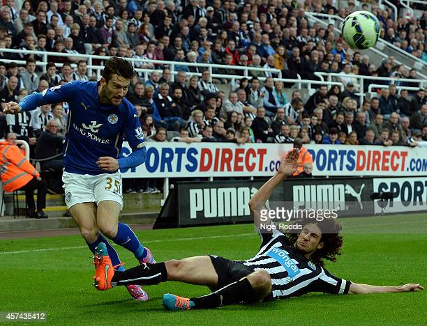 David Nugent of Leicester City crosses the ball as Fabricio Coloccini of Newcastle United sldes in during the Barclays Premier League match between...