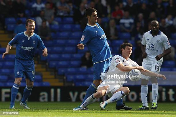 David Nugent of Leicester City is fouled by Pablo Ibanez of Birmingham City during the npower Championship match at St Andrews on October 16 2011 in...
