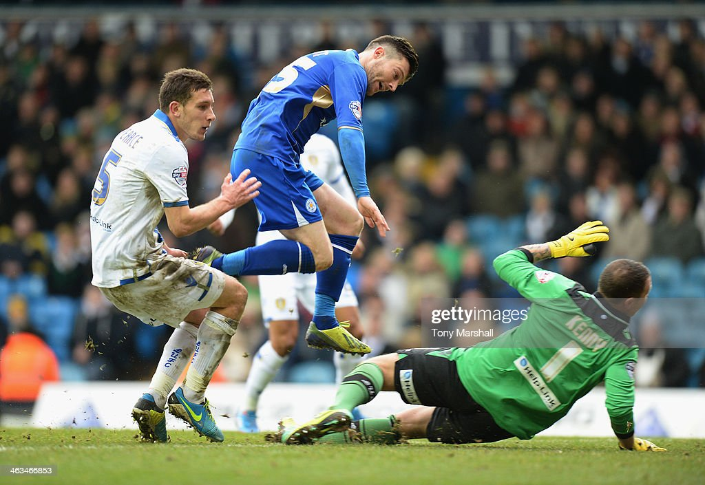 David Nugent of Leicester City jumps over Paddy Kenny of Leeds United as he scores their first goal during the Sky Bet Championship match between Leeds United and Leicester City at Elland Road on January 18, 2014 in Leeds, England,
