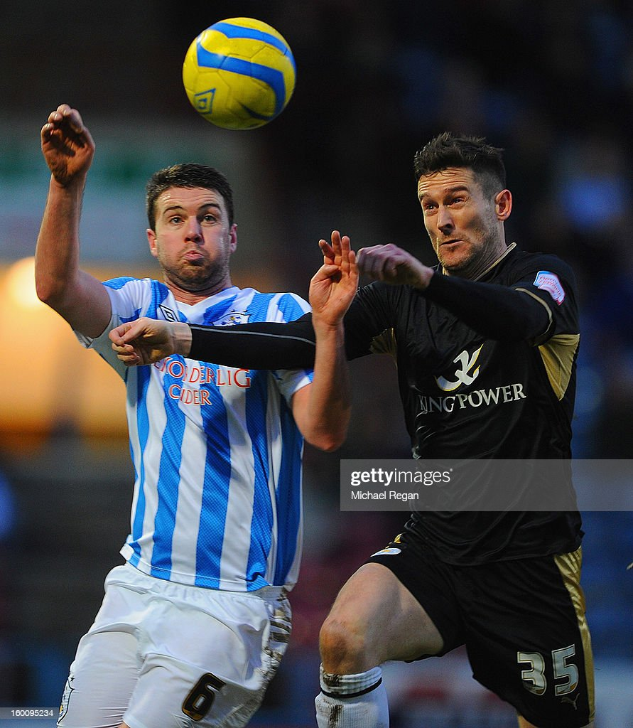 David Nugent of Leicester in action with Anthony Gerrard of Huddersfield during the FA Cup Fourth Round match between Huddersfield Town and Leicester City at the Galpharm Stadium on January 26, 2013 in Huddersfield, England.