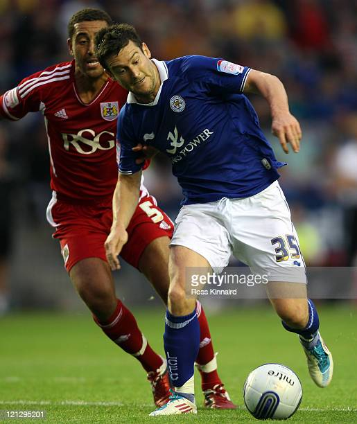 David Nugent of Leicester is challenged by Lewin Nyatanga of Bristol during the npower Championship match between Leicester City and Bristol City at...