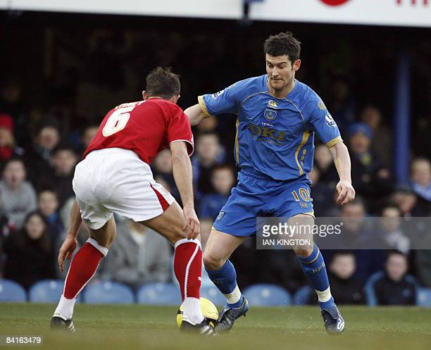 David Nugent of Portsmouth tackles Louis Carey of Bristol City during an FA Cup Third Round football match at Fratton Park in Portsmouth on January 3...