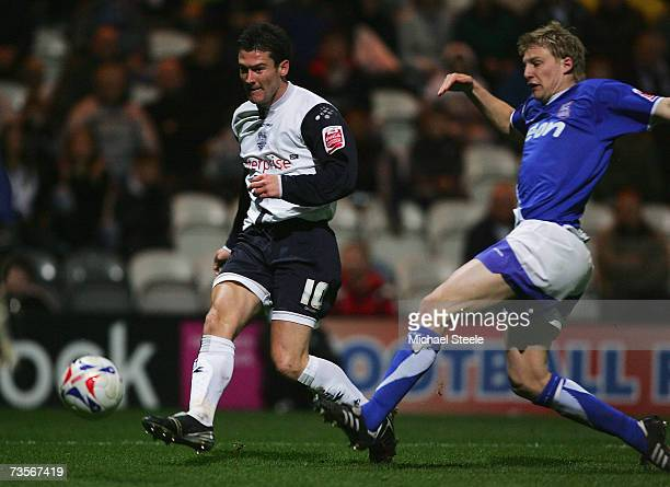 David Nugent of Preston shoots as Danny Haynes closes in during the CocaCola Championship match between Preston North End and Ipswich Town at...