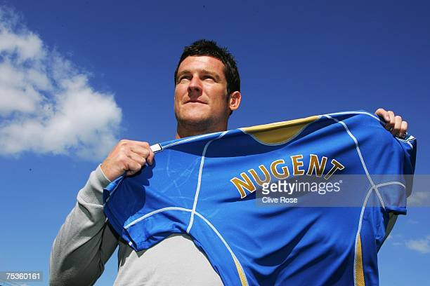 David Nugent poses with the Portsmouth shirt after a press conference at Fratton Park on July 11 2007 in Portsmouth England