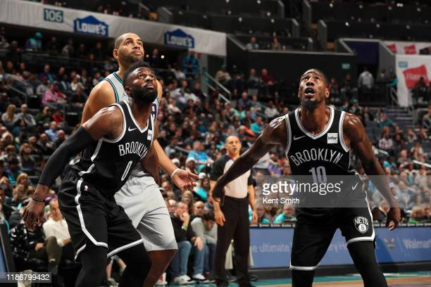 David Nwaba and Iman Shumpert of the Brooklyn Nets look on during the game against the Charlotte Hornets on December 6 2019 at Spectrum Center in...