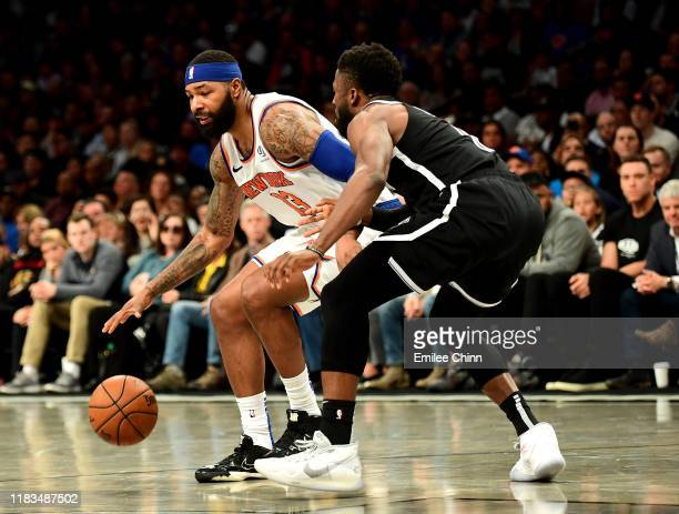 David Nwaba of the Brooklyn Nets guards Marcus Morris Sr #13 of the New York Knicks as he dribbles the ball in the second half of their game at...