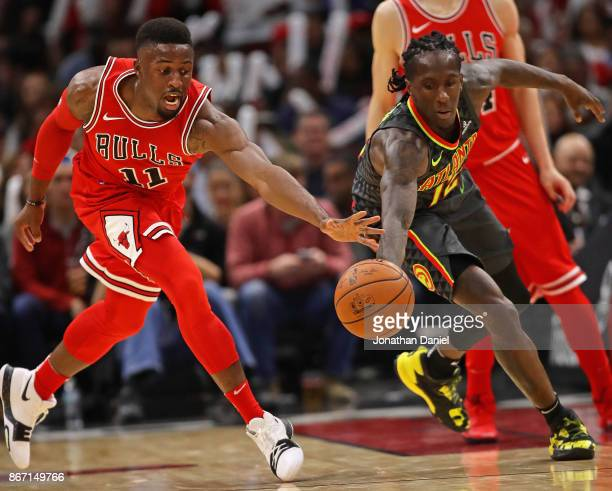 David Nwaba of the Chicago Bulls and Taurean Prince of the Atlanta Hawks chase a loose ball at the United Center on October 26 2017 in Chicago...