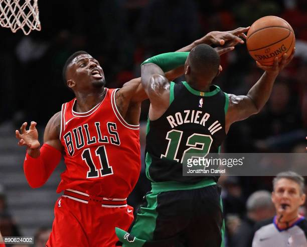 David Nwaba of the Chicago Bulls defends against Terry Rozier of the Boston Celtics at the United Center on December 11 2017 in Chicago Illinois NOTE...